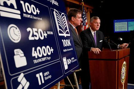 FILE PHOTO: Sen. Richard Burr (R-NC), accompanied by Sen. Mark Warner (D-VA), gives an update on the ongoing investigation into Russian involvement in the 2016 election at the Capitol Building in Washington, U.S., October 4, 2017. REUTERS/Aaron P. Bernstein/File Photo