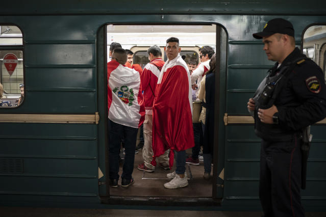 <p>Soccer fans ride in the metro near the Luzhniki stadium before the group A match between Russia and Saudi Arabia which opens the 2018 soccer World Cup in Moscow, Russia, Thursday, June 14, 2018. (AP Photo/Felipe Dana) </p>
