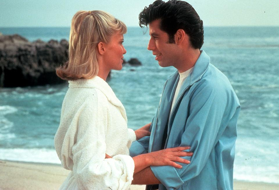 Olivia Newton John and John Travolta embrace on the beach in a scene from the film 'Grease', 1978. (Photo by Paramount/Getty Images)