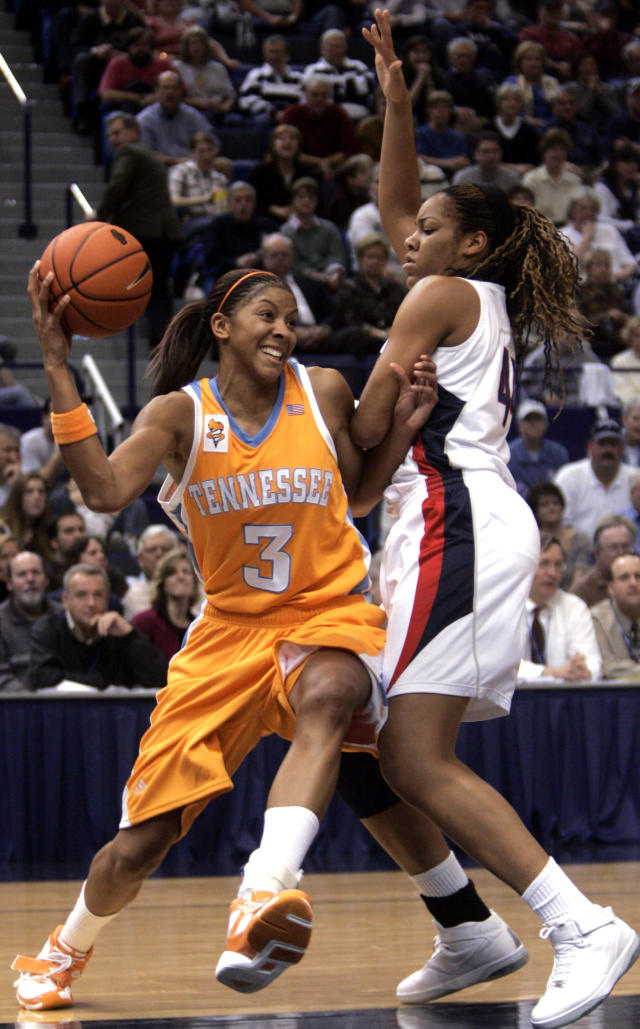 FILE - In this Jan. 6, 2007, file photo, Tennessee's Candace Parker (3) drives past Connecticut's Brittany Hunter for a shot in the second half of an NCAA college basketball game in Hartford, Conn. For over a decade the rivalry in women's basketball was Tennessee and UConn. After a 13-year absence the two teams will play Thursday night, Jan. 23, 2020, in Hartford, Connecticut. (AP Photo/Bob Child, File)