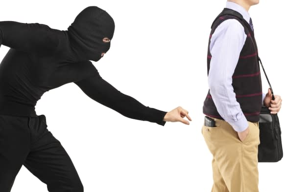 'Pickpocket trying to steal a wallet from a man, isolated on white'