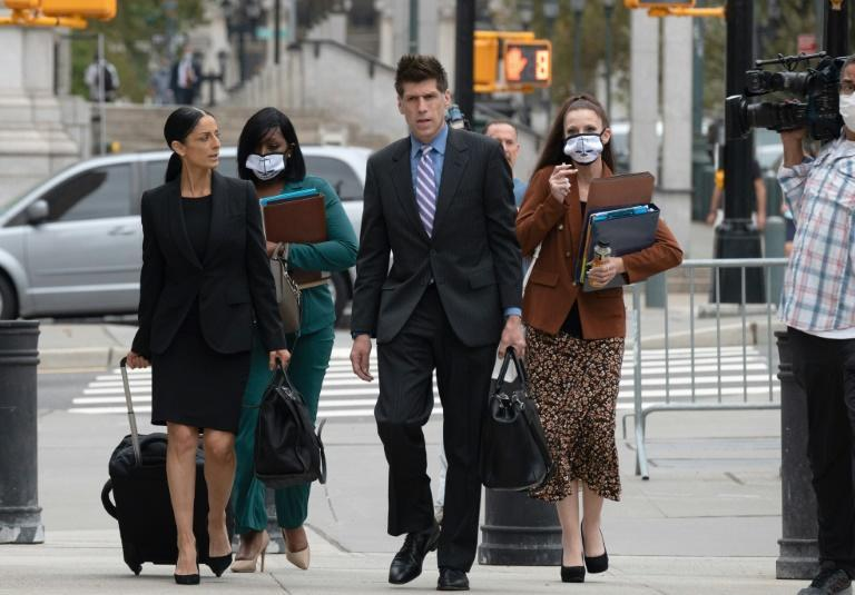 R. Kelly's lawyers arrive for the start of his trial in Brooklyn, New York on August 18, 2021
