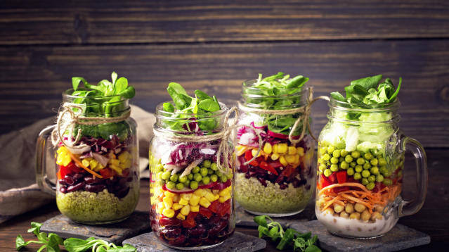 The Mason jar has many different roles in the kitchen, and holding salads is one of the newer ones.
