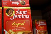 Boxes of Aunt Jemima branded pancake mix stand on a store shelf inside of a shop in the Brooklyn borough of New York City