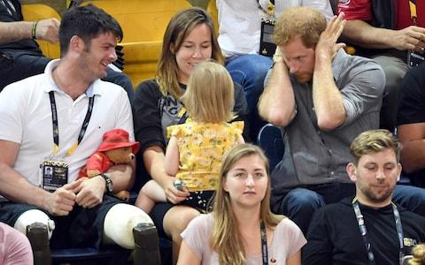 Prince Harry with British Paralympian Dave Henson, his wife Hayley Henson and their two-year-old daughter Emily  - Credit: Karwai Tang/WireImage