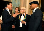 2017 Kennedy Center Honorees singer Lionel Ritchie (L), TV writer Norman Lear (C) and Rapper LL Cool J chat among themselves at the conclusion of a gala dinner at the U.S. State Department, in Washington, U.S., December 2, 2017. REUTERS/Mike Theiler