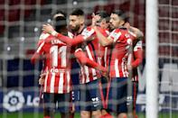 Atletico Madrid players celebrate one of their goals in a 3-1 win over Valencia in La Liga on Sunday