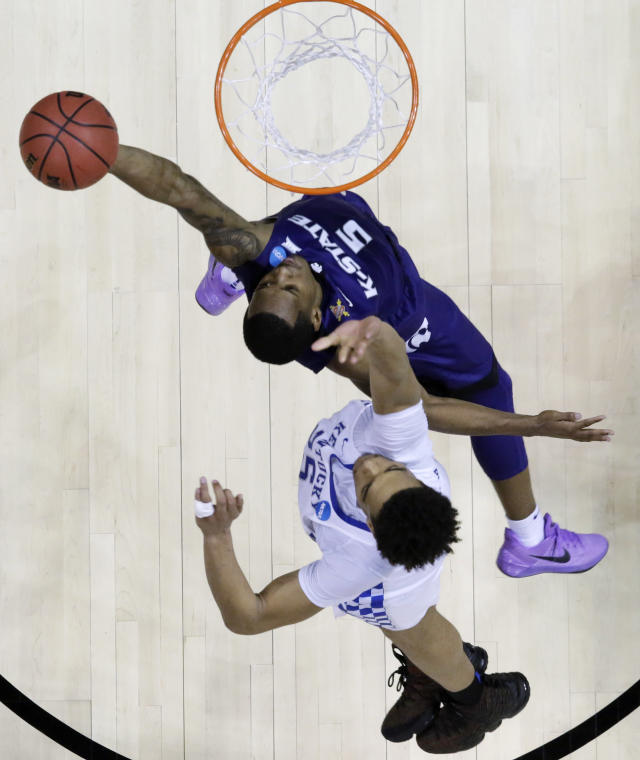 Kansas State guard Barry Brown (5) shoots as Kentucky forward PJ Washington (25) defends during the second half of a regional semifinal NCAA college basketball tournament game, Friday, March 23, 2018, in Atlanta. Kansas State won 61-58. (AP Photo/David Goldman)