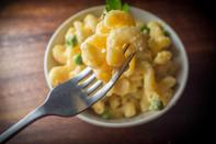 <p>Mac 'n' cheese is an easy, potluck classic this time of year. While the dish is always a party favourite, too much pasta, heavy cream and cheese can do a number on your waistline. To lighten up this old faithful, swap heavy cream for puréed squash. You'll still reap the creamy benefits but without the high calorie additional cream. </p>
