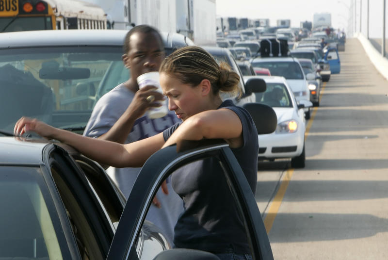Martha Velazquez stands on the road in stalled traffic in eastern Houston as people try to evacuate in advance of Hurricane Rita on Sept. 22, 2005. (Rick Wilking / Reuters)