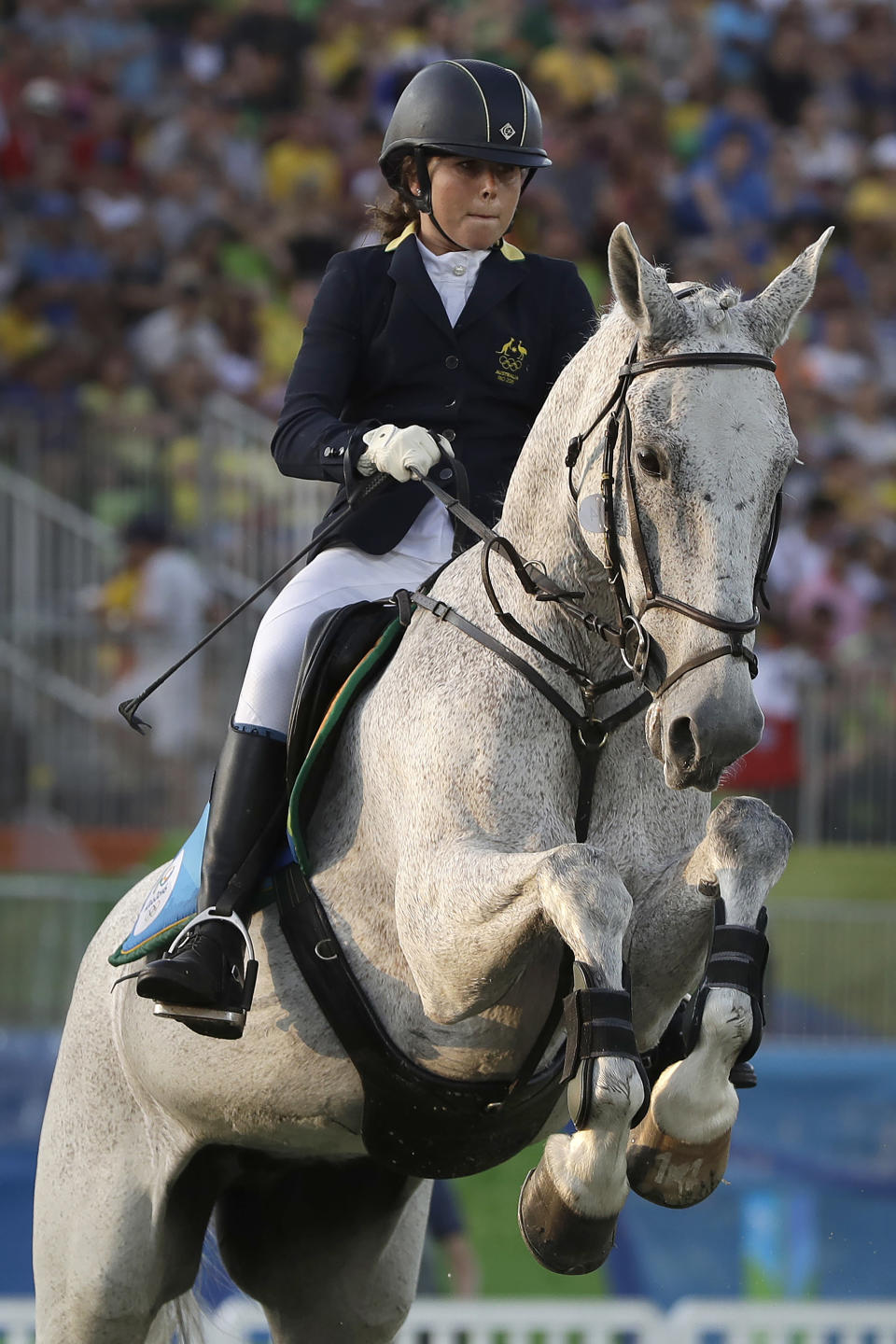 "FILE - In this Aug. 19, 2016, file photo, gold medal winner Chloe Esposito of Australia competes in the equestrian portion of the women's modern pentathlon at the Summer Olympics in Rio de Janeiro, Brazil. Esposito announced in late January that a ""wonderful, unexpected surprise"" had occurred and that the Australian wouldn't be able to defend her modern pentathlon gold medal at the Tokyo Olympics. She was pregnant with her first child. Two months later Esposito and thousands of other Olympic athletes learned that the Tokyo Games would be put off by a year until July 2021 because of the coronavirus pandemic. While for some it meant more time to recover from injuries or extra time to prepare, Esposito realized it might give her a second chance to be in Tokyo next year. (AP Photo/Kirsty Wigglesworth, File)"