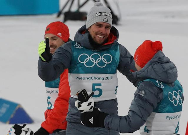 Nordic Combined Events - Pyeongchang 2018 Winter Olympics - Men's Individual 10 km Final - Alpensia Cross-Country Skiing Centre - Pyeongchang, South Korea - February 20, 2018 - Gold medalist, Johannes Rydzek of Germany reacts with bronze medalist Eric Frenzel of Germany. REUTERS/Carlos Barria