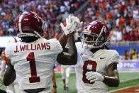 Alabama wide receiver John Metchie III (8) celebrates with wide receiver Jameson Williams (1) after a touchdown catch during the first half of an NCAA college football game against Miami, Saturday, Sept. 4, 2021, in Atlanta. (AP Photo/John Bazemore)