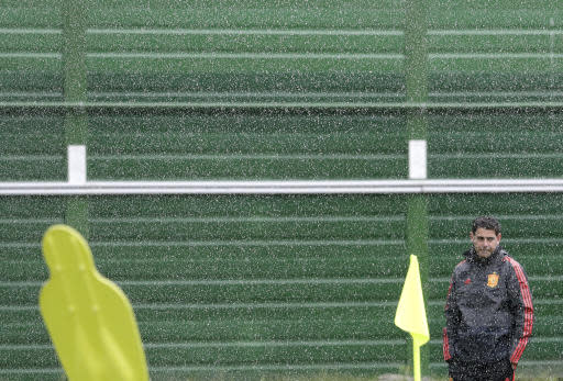 Spain head coach Fernando Hierro arrives for the official training on the eve of the group B match between Morocco and Spain at the Mirny stadium in Kaliningrad, Russia, Sunday, June 24, 2018. (AP Photo/Petr David Josek)
