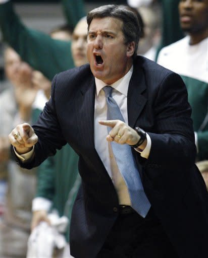Tulane head coach Ed Conroy calls a play during the second half of an NCAA college basketball game against the UTEP in New Orleans, Saturday, Jan. 21, 2012. Tulane won 66-58.(AP Photo/Jonathan Bachman)