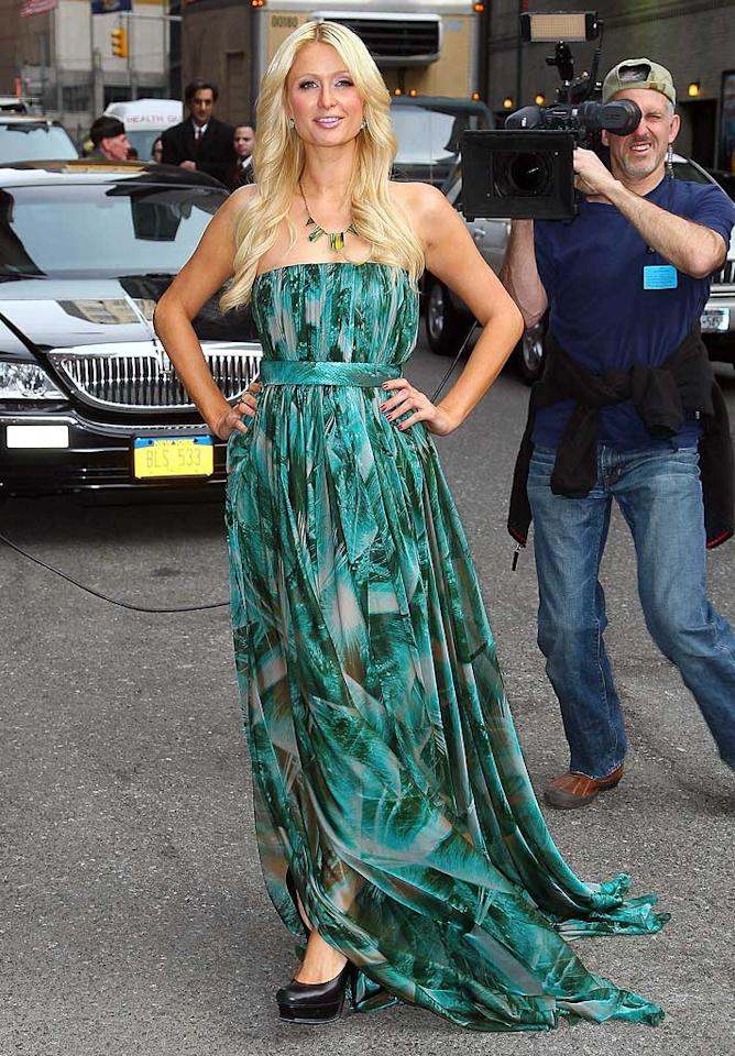 """Paris Hilton took a break from her 30th birthday festivities to pop by the Ed Sullivan Theater -- in a multi-colored maxi dress and House of Harlow 1960 statement necklace -- to chat with Dave Letterman about her empire and boyfriend, Cy Waits. Jeffrey Ufberg/<a href=""""http://www.wireimage.com"""" target=""""new"""">WireImage.com</a> - February 17, 2011"""
