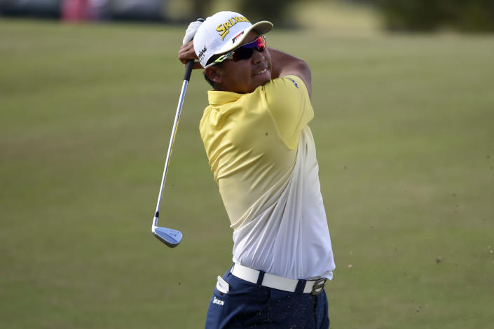 Hideki Matsuyama hits his second shot on the 18th hole during the final round of the Houston Open golf tournament, Sunday, Nov. 8, 2020, in Houston. (AP Photo/Eric Christian Smith)