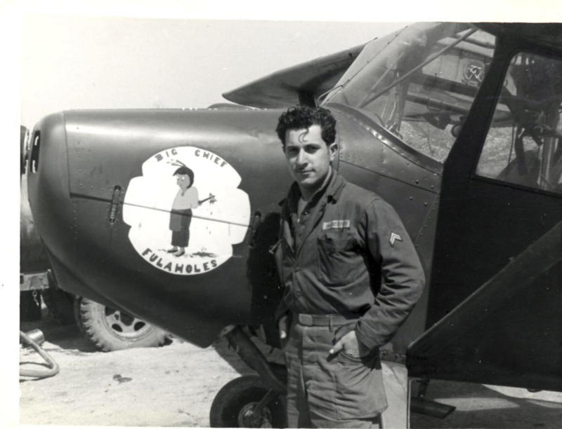 "This undated photograph provided by American Airlines shows Azriel ""Al"" Blackman posing with an airplane while serving in the army during the Korean war.  American Airlines is celebrating the 70-year service of a New York City mechanic who says he has no plans to retire. Azriel ""Al"" Blackman was 16 years old when he started as an apprentice mechanic in July of 1942. (AP Photo/American Airlines)"