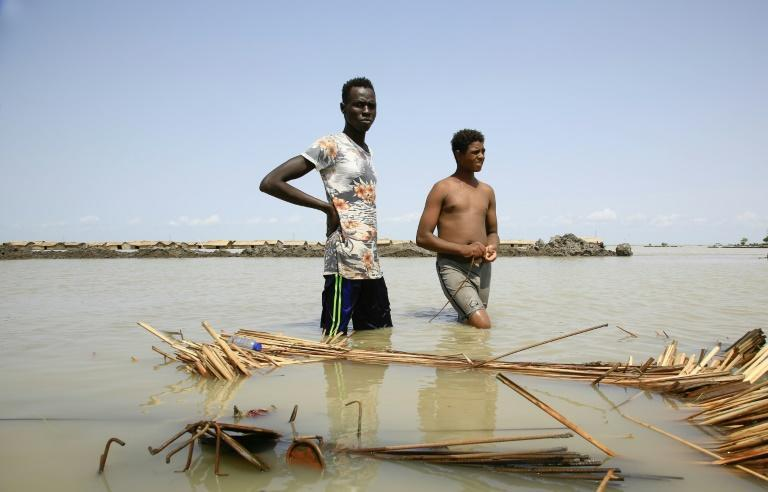 Authorities say the floods have damaged or destroyed around 35,000 homes (AFP/ASHRAF SHAZLY)