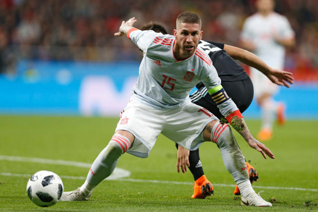 FILE - In this Tuesday, March 27, 2018 file photo, Spain's Sergio Ramos plays the ball during the international friendly soccer match between Spain and Argentina at the Wanda Metropolitano stadium in Madrid. (AP Photo/Francisco Seco, File)