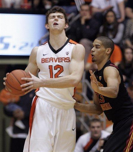 Oregon State center Angus Brandt, left, reacts after he was hit in the face by Southern California guard Byron Wesley during the first half of an NCAA college basketball game in Corvallis, Ore., Saturday, Jan. 21, 2012. (AP Photo/Don Ryan)