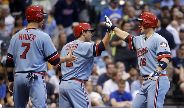 Minnesota Twins' Josh Willingham (16) is congratulated by Joe Mauer (7) and Brian Dozier (2) after hitting a three-run home run during the third inning of a baseball game against the Milwaukee Brewers on Tuesday, June 3, 2014, in Milwaukee. (AP Photo/Morry Gash)