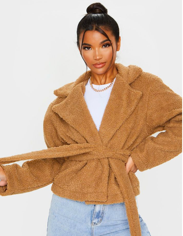 """On mornings when you're having separation anxiety with your bathrobe, this plush wrap jacket will serve as a cozy substitute. $45, Pretty Little Thing. <a href=""""https://www.prettylittlething.us/cream-borg-tie-waist-jacket.html"""" rel=""""nofollow noopener"""" target=""""_blank"""" data-ylk=""""slk:Get it now!"""" class=""""link rapid-noclick-resp"""">Get it now!</a>"""