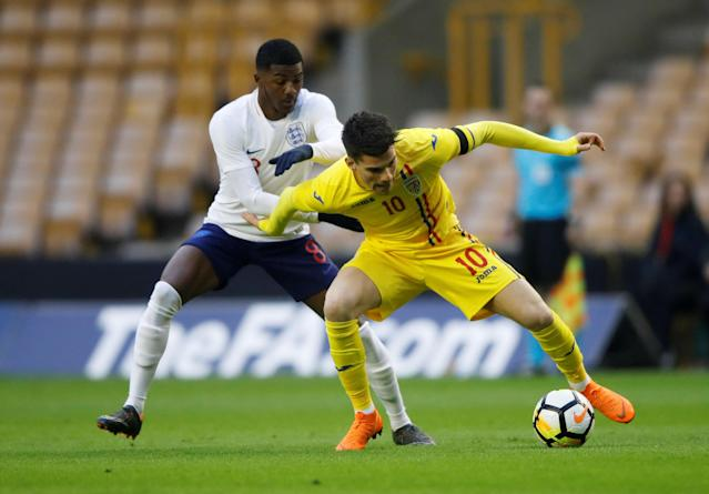 Soccer Football - Under 21 International Friendly - England vs Romania - Molineux Stadium, Wolverhampton, Britain - March 24, 2018 England's Ainsley Maitland-Niles in action with Romania's Ianis Hagi Action Images via Reuters/Carl Recine