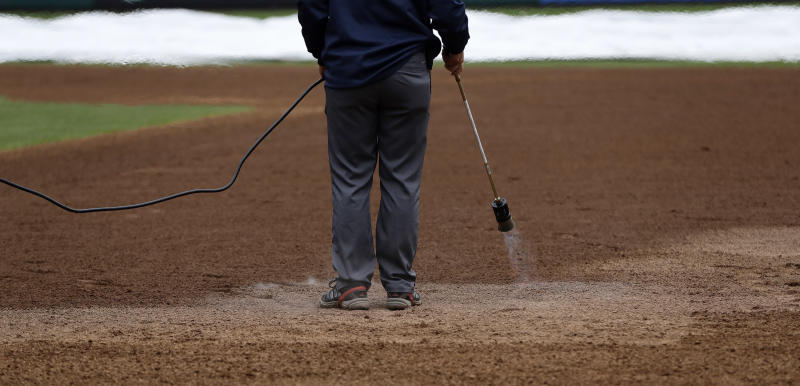 A grounds crew member heats the infield of Citizens Bank Park before a baseball game between the Philadelphia Phillies and Washington Nationals, Monday, Sept. 10, 2018, in Philadelphia. (AP Photo/Matt Slocum)