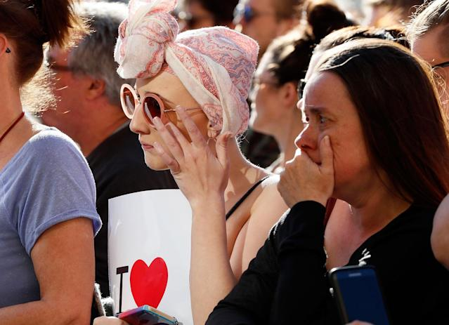 <p>People attend a vigil in Albert Square, Manchester, England, Tuesday May 23, 2017, the day after the suicide attack at an Ariana Grande concert that left 22 people dead as it ended on Monday night. (AP Photo/Kirsty Wigglesworth) </p>