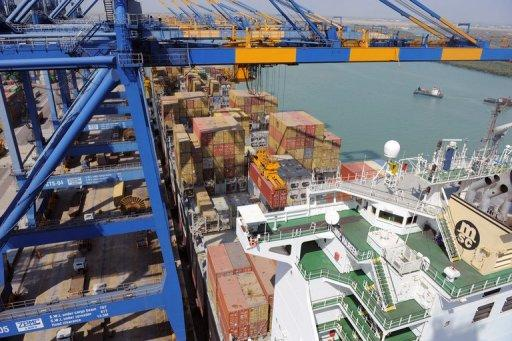 A container ship is unloaded at the Mundra Port and Special Economic Zone