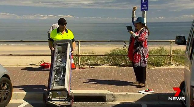 A resident cheers while a meter is removed. Source: 7 News