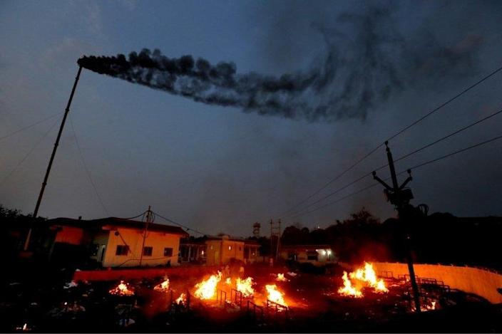 General view showing the burning of funeral pyres when relatives perform the last rites for the victims of covid-19 in Bhopal, India, April 15, 2021.