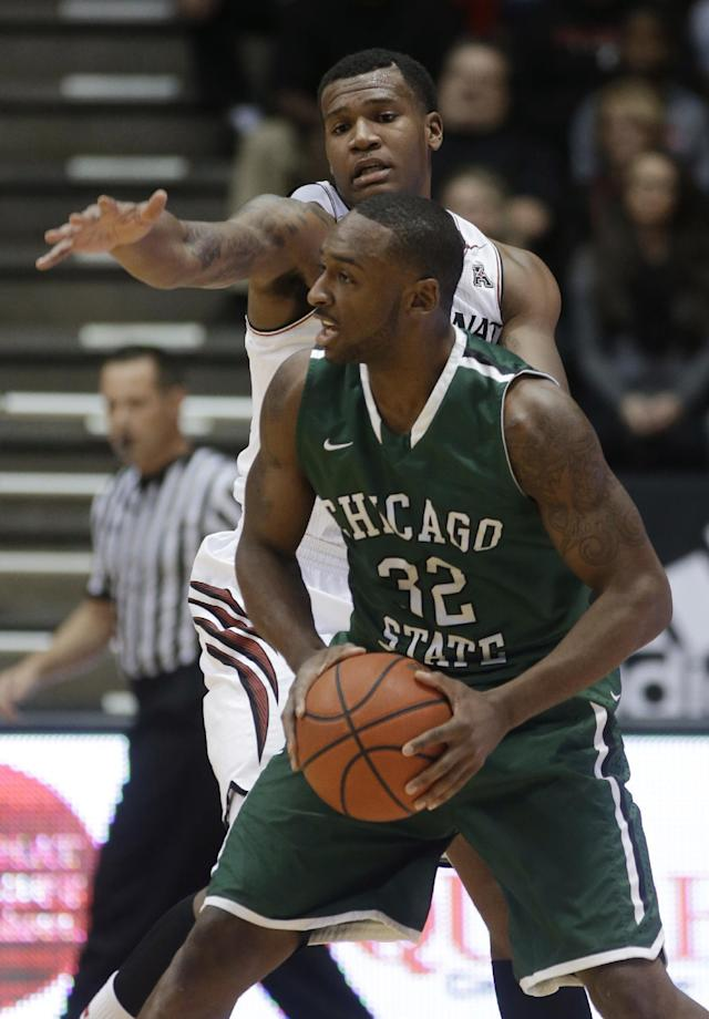Chicago State guard Nate Duhon (32) looks to pass the ball away from Cincinnati forward Jermaine Sanders during the first half of an NCAA college basketball game, Monday, Dec. 23, 2013, in Cincinnati. (AP Photo/Al Behrman)