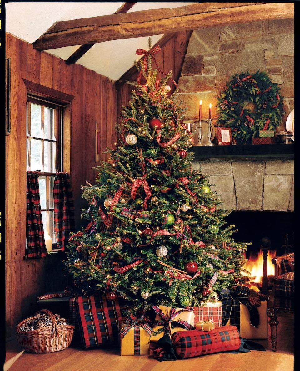 """<p>Bring on the plaid! For many, it just isn't Christmas until you've decked the halls with red tartan plaid. Woven around your tree as a garland, classic red-and-green plaid ribbons in tartan patterns, such as Stewart and Chisholm, give your Christmas tree a simple, homespun feel. Even better, layer ribbons in a mix of different tartan designs. Then tie a big-looped bow on the top branch as a ribbon tree topper, and you're ready to celebrate. And don't forget your plaid-wrapped packages to layer on even more festive tartan! </p><p><a class=""""link rapid-noclick-resp"""" href=""""https://go.redirectingat.com?id=74968X1596630&url=https%3A%2F%2Fwww.etsy.com%2Fsearch%3Fq%3Dtartan%2Bribbon&sref=https%3A%2F%2Fwww.countryliving.com%2Fhome-design%2Fdecorating-ideas%2Fg28703522%2Fchristmas-tree-ribbon-ideas%2F"""" rel=""""nofollow noopener"""" target=""""_blank"""" data-ylk=""""slk:SHOP TARTAN PLAID RIBBON"""">SHOP TARTAN PLAID RIBBON</a></p>"""