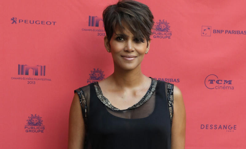 "FILE - In this June 13, 2013 file photo, actress Halle Berry arrives at the screening of the film ""Things we Lost in the Fire"" with the french title ""Nos Souvenirs Brules"" during the Champs-Elysees Film Festival, at the ""Publicis Cinema"" in Paris. CBS says Berry will star in a serialized drama coming to the network next summer. The Oscar-winning actress will headline ""Extant,"" a 13-episode thriller. (AP Photo/Francois Mori, File)"