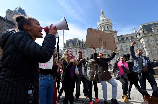 Students are seen participating in Tuesday's walkout to protest gun violence in schools and Baltimore.