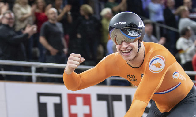 Harrie Lavreysen from the Netherlands celebrates after winning the gold meda in team sprint men final during the Track Cycling World Championships in Berlin Wednesday, Feb. 26, 2020. (Photo: Sebastian Gollnow/dpa via AP)