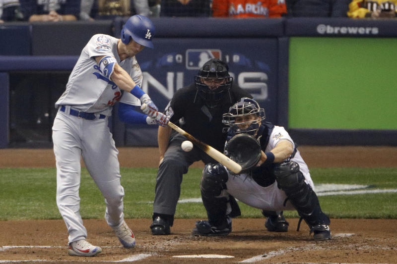 Los Angeles Dodgers' Cody Bellinger (35) hits a two-run home run during the second inning of Game 7 of the National League Championship Series baseball game against the Milwaukee Brewers Saturday, Oct. 20, 2018, in Milwaukee. (AP Photo/Charlie Riedel)