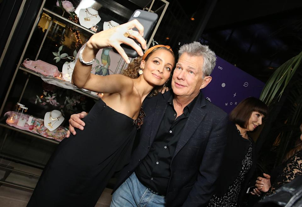 Nicole Richie and David Foster take a selfie at Yahoo Lifestyle's NowWith shopping video launch in Los Angeles. (Photo: Getty Images)