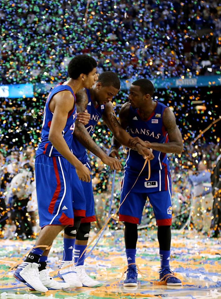 Kevin Young #40, Thomas Robinson #0 and Tyshawn Taylor #10 of the Kansas Jayhawks walk off the court after losing to the Kentucky Wildcats 67-59 in the National Championship Game of the 2012 NCAA Division I Men's Basketball Tournament at the Mercedes-Benz Superdome on April 2, 2012 in New Orleans, Louisiana. (Photo by Ronald Martinez/Getty Images)