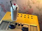 """<p><strong>Where to Get It: </strong>50's Prime Time Cafe at Disney's Hollywood Studios ($7) <strong>Lou's Review: </strong>""""Turn back time and head to this restaurant where you can order a variety of inventive shakes. Of course, your server will tell you (politely) that you can't have your dessert if you don't finish your vegetables and clean your plate, but when you do, the PB&J milkshake can't be missed! One sip and you will be transported back to your childhood, as it combines every kid (and kid-at-heart's) favorites: creamy peanut butter, sweet jelly, and ice cream, into a delicious trip down memory lane. Don't want to sit down for a full meal? You can also order it from the adjacent Tune-In Lounge.""""</p>"""
