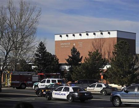 Police and rescue workers arrive at Arapahoe High School, after a student opened fire in the school in Centennial, Colorado