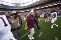 Texas A&M head coach Jimbo Fisher heads off the field after the second half of an NCAA college football game against Colorado, Saturday, Sept. 11, 2021, in Denver. Texas A&M won 10-7. (AP Photo/David Zalubowski)