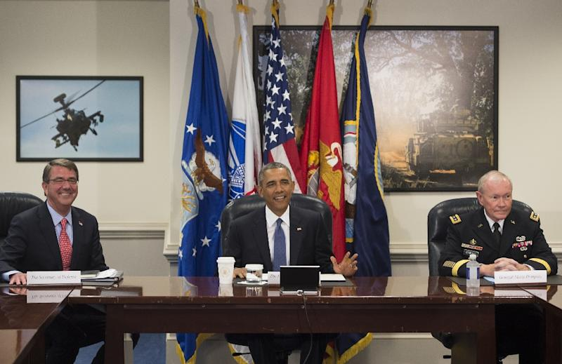 President Barack Obama holds a meeting with Secretary of Defense Ashton Carter (L), Chairman of the Joint Chiefs of Staff Martin Dempsey (R) and top military officials at the Pentagon, July 6, 2015