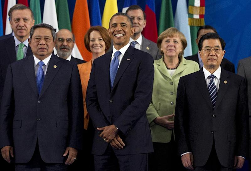 President Barack Obama takes his place with other leaders for the Family Photo during the G20 Summit, Monday, June 18, 2012, in Los Cabos, Mexico. From left, Turkish Prime Minister Recep Tayyip Erdogan, Indonesian President Susilo Bambang Yudhoyono, Jose Graziano da Silva, Australian Prime Minister Julia Gillard, U.S. President Barack Obama, Spanish Prime Minister Mariano Rajoy, German Chancellor Angela Merkel, Chinese President Hu Jintao. (AP Photo/Carolyn Kaster)