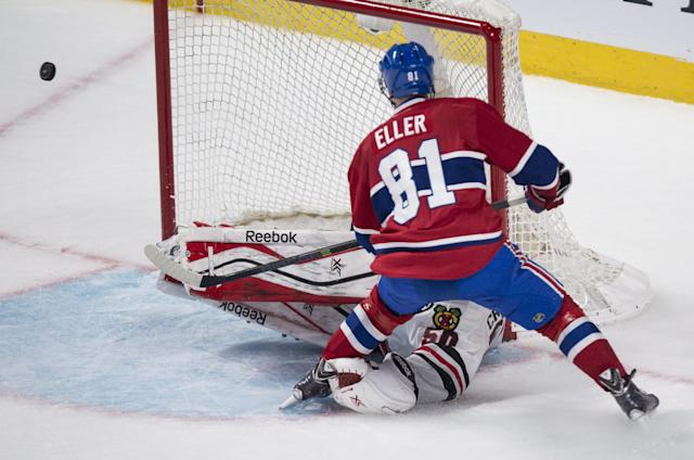 Montreal Canadiens' Lars Eller misses an open net while Chicago Blackhawks goalie Corey Crawford is down on the ice during the second period of an NHL hockey game, Saturday, Jan. 11, 2014, in Montreal. (AP Photo/The Canadian Press, Paul Chiasson)
