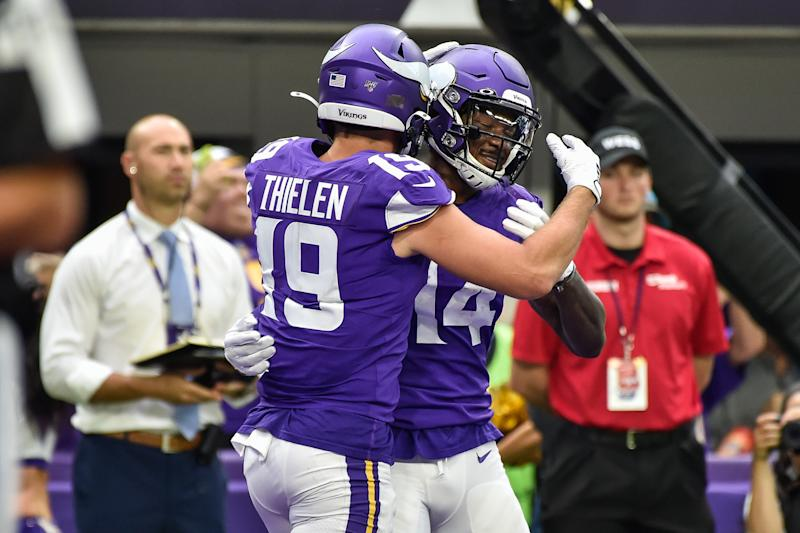 Sep 22, 2019; Minneapolis, MN, USA; Minnesota Vikings wide receiver Adam Thielen (19) and wide receiver Stefon Diggs (14) react after a touchdown by Thielen during the second quarter against the Oakland Raiders at U.S. Bank Stadium. Mandatory Credit: Jeffrey Becker-USA TODAY Sports