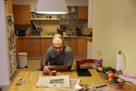 Doctor Guy Choshen drinks coffee at his home before heading to work as director of the COVID-19 ward in Ichilov Hospital in Tel Aviv