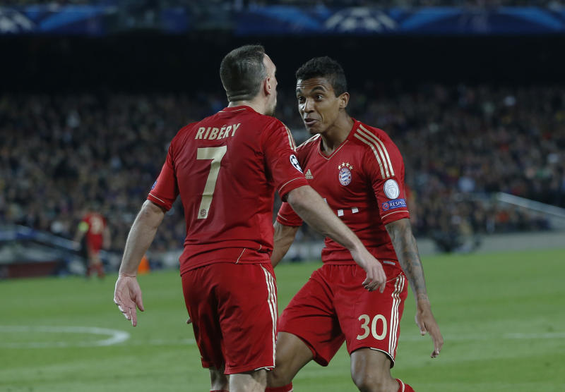 Bayern's Franck Ribery of France, left, celebrates with Luiz Gustavo of Brazil, right, their team's second goal during the Champions League semifinal second leg soccer match between FC Barcelona and Bayern Munich at the Camp Nou stadium in Barcelona, Spain, Wednesday, May 1, 2013. (AP Photo/Matthias Schrader)